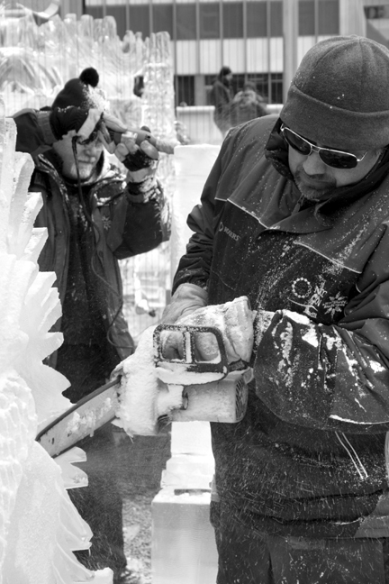 Ted Hayes and Tyler Hayes use tools to ice sculpt.